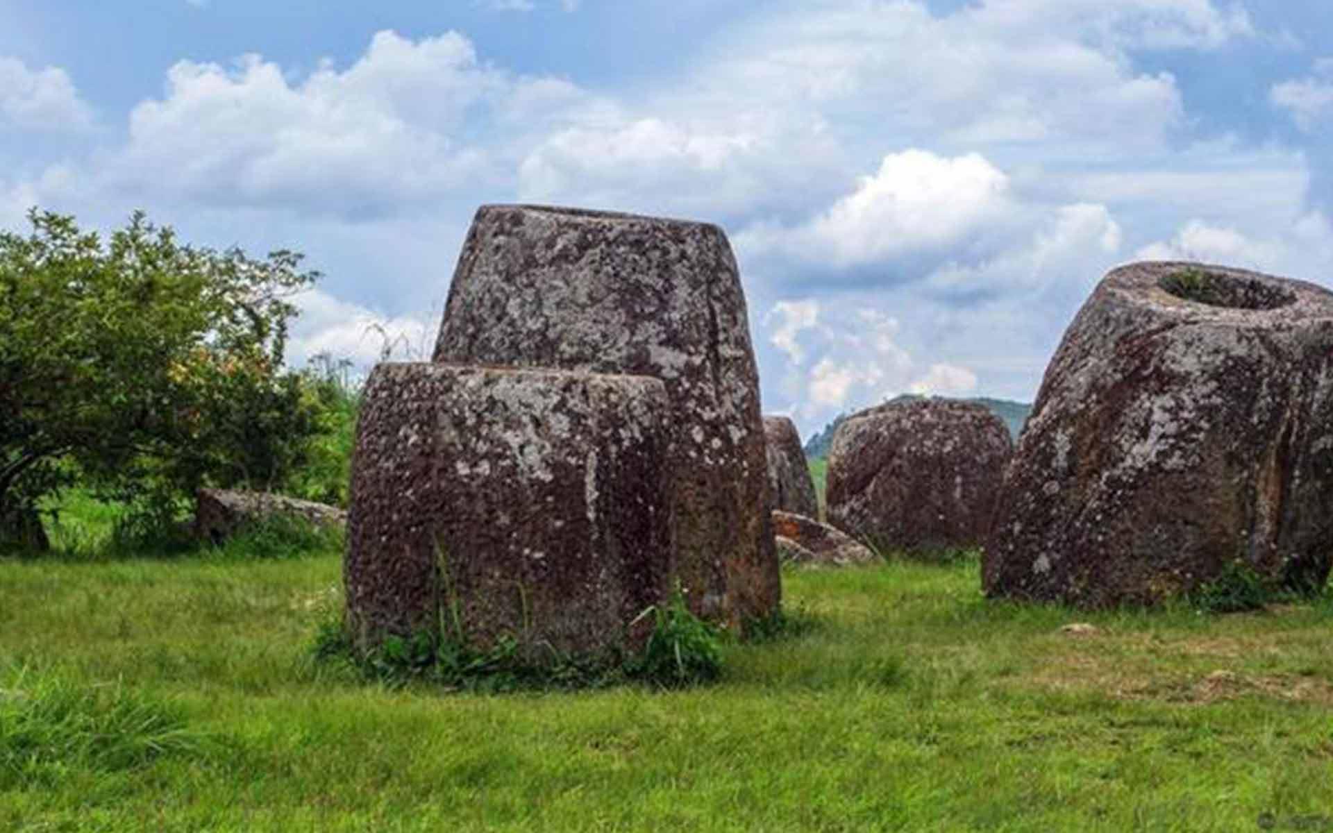 huge ancient stone jars in laos