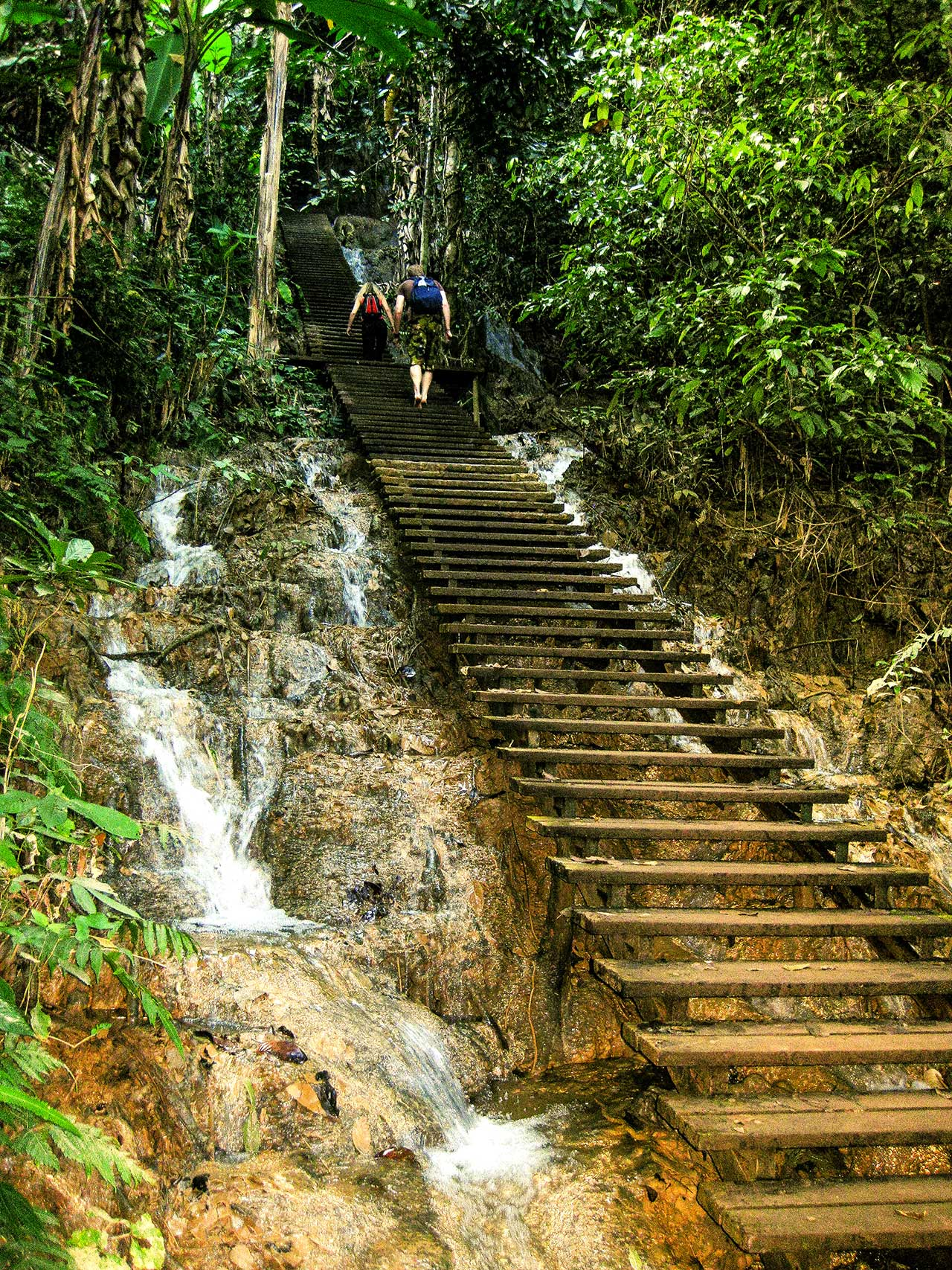 hiking to the top of Kuang Si Waterfall