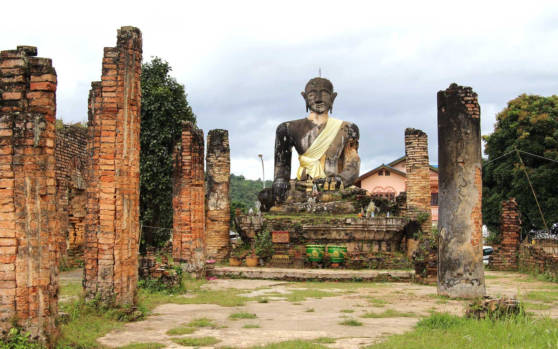 Buddha statue in the ruins of Wat Phia Wat temple in Muang Khoun.
